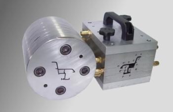 Głowica z układem kalibrująco - chłodzącym do profilu komorowego, OBR-ERG